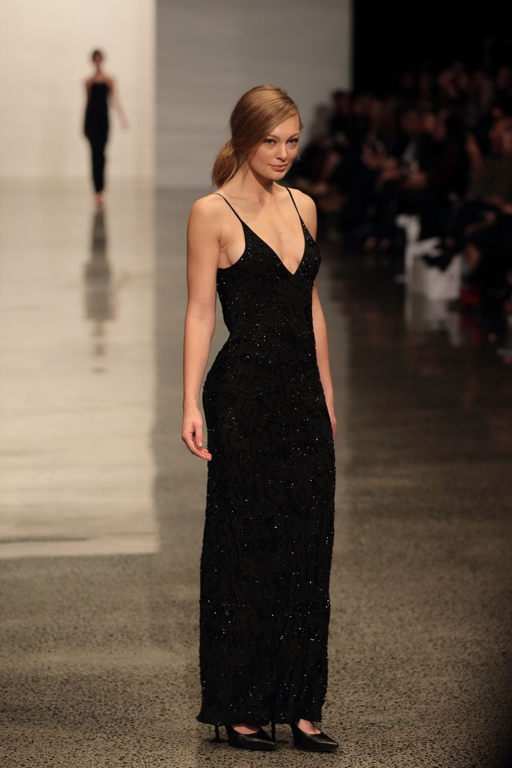 NZ Fashion Week 2014 EQUUS DRESS BLACK This limited edition piece is truly one for special occasions.  To stand out in the crowd with it's dramatic simplicity, it takes hundred of hours (15 days in fact)  to carefully hand bead each dress, and it is one to cherish for life. #tkstore