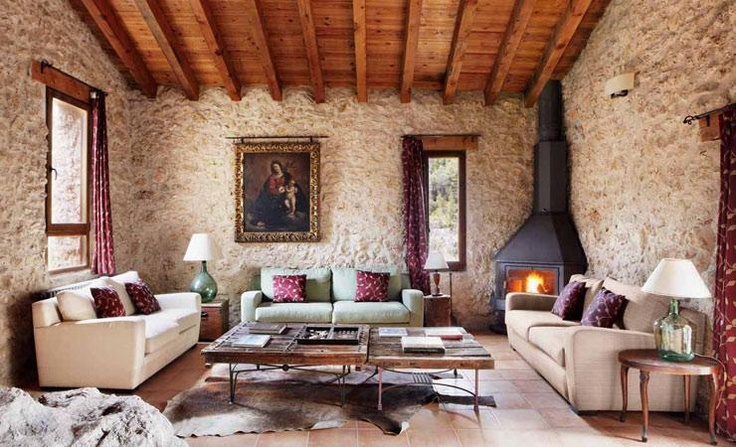 Mas de la Serra. A #converted #farmhouse on the edge of the Iberian coastal mountains: the epitome of #rural #spain. Bare stone walls, terracotta flooring, animal hides, a fireplace and exposed wooden beams add a #rustic charm.