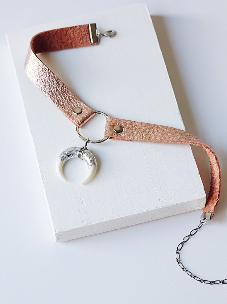 Foiled Horn Leather Choker   American made leather choker with a center ring and…