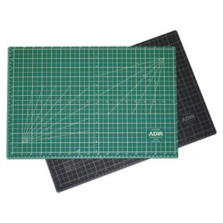 @Overstock.com - Adir Self-healing Reversible Green/ Black Cutting Mat (18 x 24) - Constructed with a self-healing surface, this cutting mat is extremely durable and holds up under repeated use with art and mat knives or rotary cutters.The cutting mat is the ideal choice for artists, scrapbookers and hobbyists.  http://www.overstock.com/Office-Supplies/Adir-Self-healing-Reversible-Green-Black-Cutting-Mat-18-x-24/7654964/product.html?CID=214117 $19.99