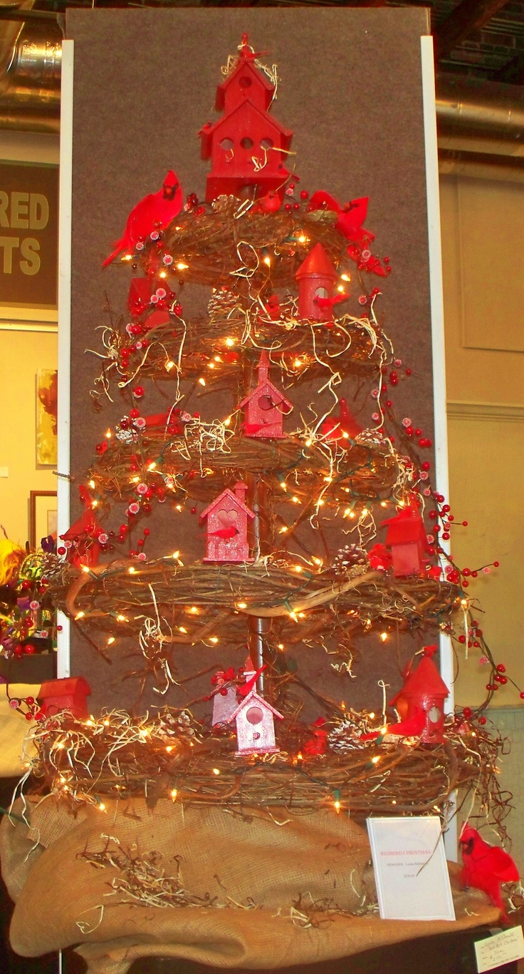 """Designer Christmas Tree """"Redbird Christmas""""  made with 5 grapevine wreaths hung with covered wire around closet rod, using birdhouses and redbirds etc. all from Michaels  Store. More details upon request. Designed for Cathedral Square Art Gallery, Mobile, Al"""