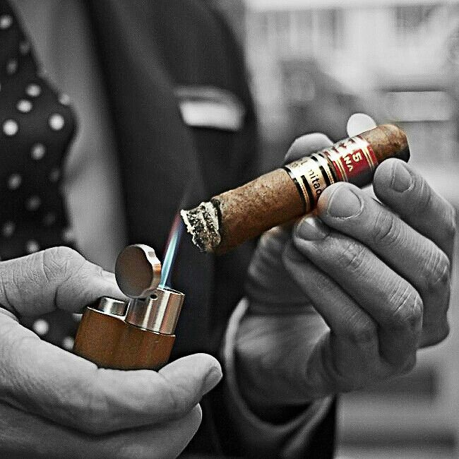L〰Toasting a cigar - Always do this, helps for an even burn and ash on the cigar