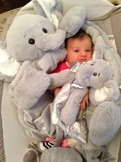 "Surrounded by Lil Spout security blanket and Lil Spout comfy cozy this little girl loves her lucky plush elephants. Discover all of the beautiful plush comfy cozies and belly blankets available for your baby. Use code ""pin"" for 15% off."