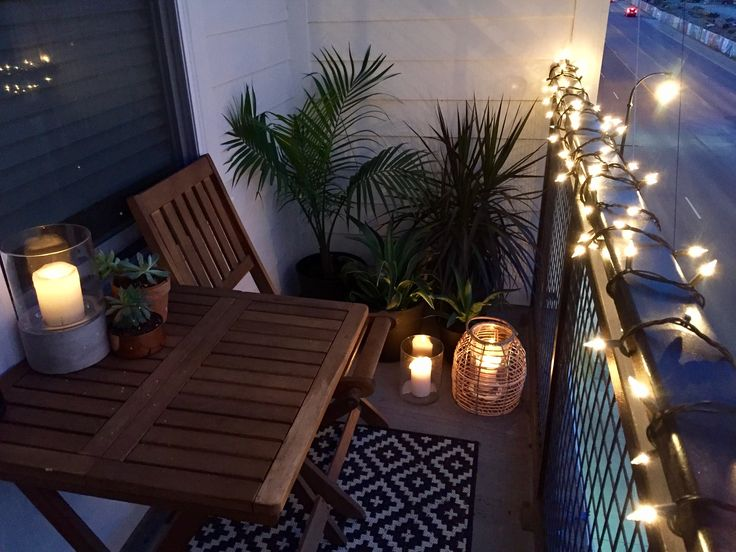 Small balcony design ideas. Target, World Market, Home Depot. Candles, tropical plants, string lights, and lanterns