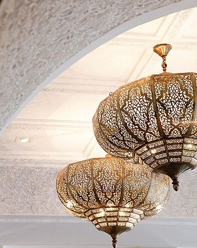 a Moorish style perforated brass pendant. Looking like gold lace with its fine detail work.