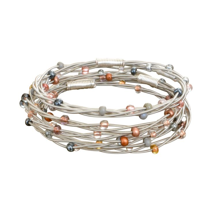 Beaded Guitar String Bangle- Copper- $24 Our copper bangle is elemental! Copper and silver hued glass beads adorn this simple guitar string bangle bracelet