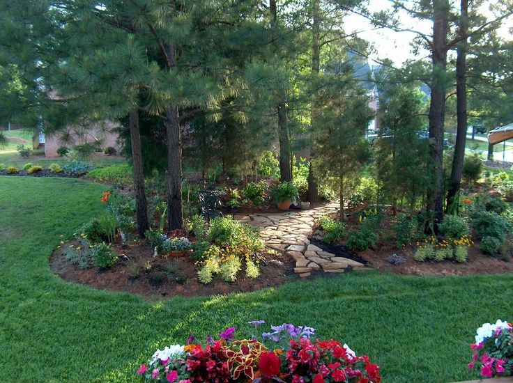 Traditional Landscape/Yard with Monrovia Coleus, Monrovia Coreopsis, exterior stone floors, Pathway