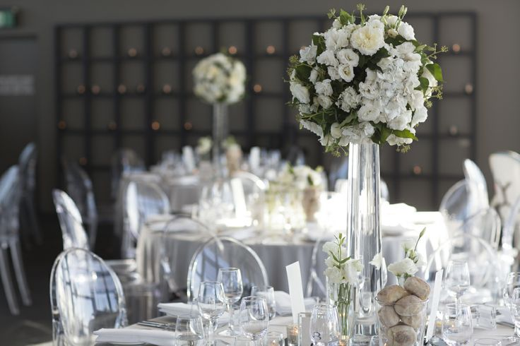 wedding flowers mirrors tea lights evening ghost chairs dinner celebrations luminare melbourne