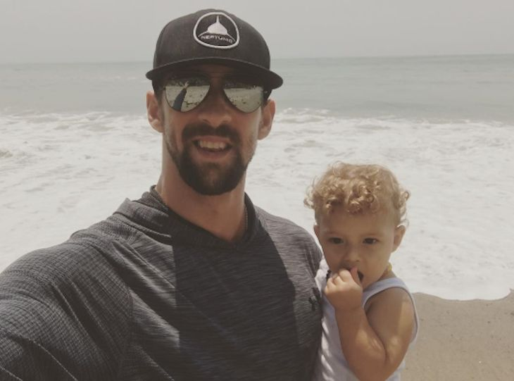 When Michael Phelps isn't winning gold medals at the Summer Olympic games or racing sharks in the middle of the ocean, he's doing what he loves the most, and that's spending time with his family.The swimmer's wife Nicole Phelps recently shared an adorable photo of the swimming sensation with their 1
