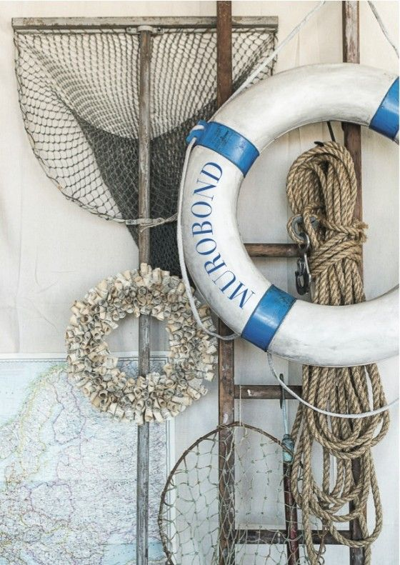 Blue and white life saving ring with nets and ropes, this is a great way to get that beachy look and feel in your home