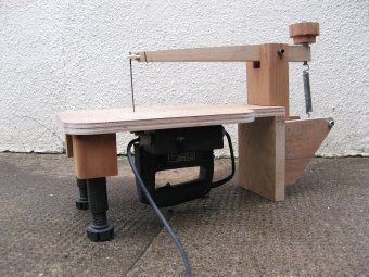 Home Made Scroll Saw: This project was designed to make use of an old jigsaw which had a broken blade holder and trigger switch, and old coffee table leg and other repurposed scraps.