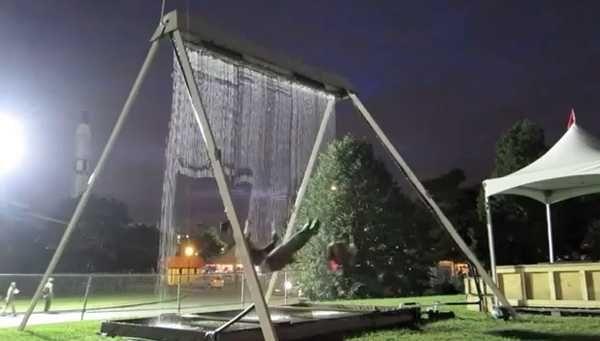 Fun Backyard Idea Blending Swing Design with Sensor Controlled Waterfall