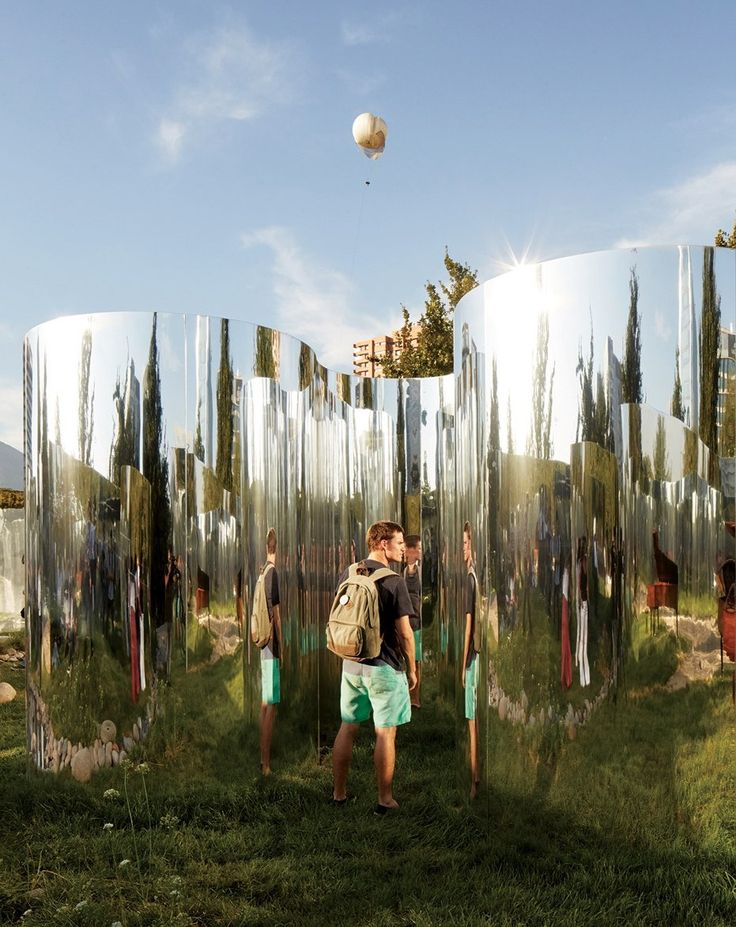Distorting mirrors frame a secret garden in Santiago's Parque Araucano