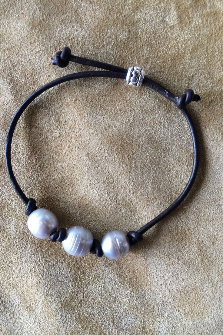 Fresh water pearls on dark leather.                                                                                                                                                     More