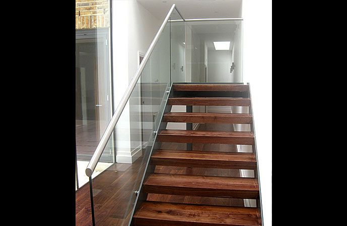 This simple and cost effective stair was constructed in powder coated mild steel carriage, toughened glass balustrade, with satin polished stainless steel handrail and hardwood timber treads.