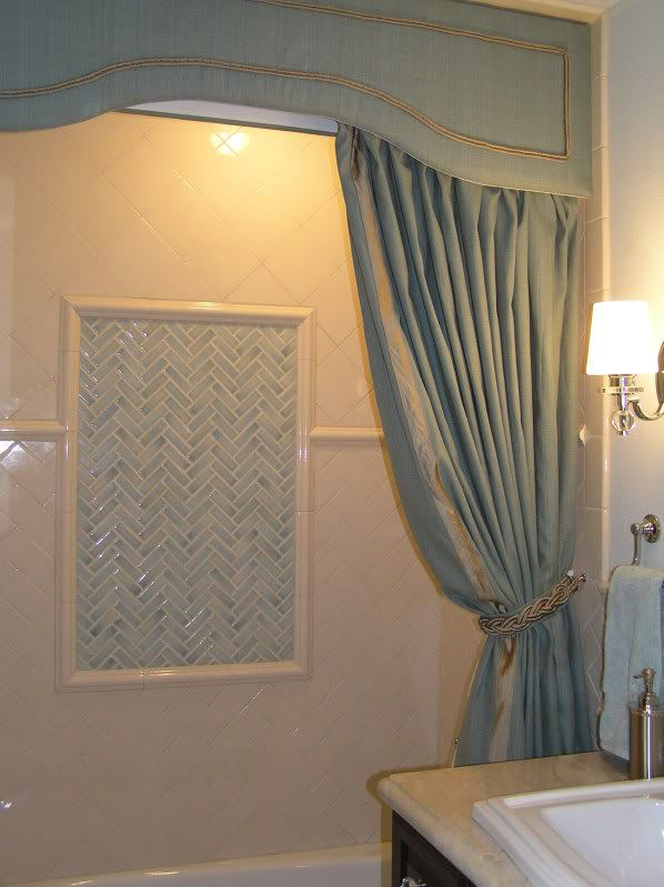 cornice + 2 extra long shower curtains make for a very elegant touch to a bathroom!