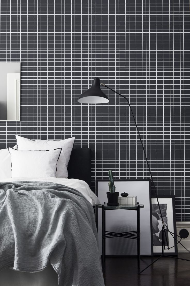 A modern, minimal wallpaper design featuring a white grid pattern on