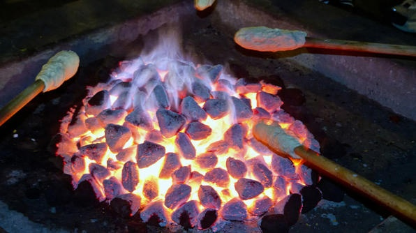 Stick bread is cooked over a fire and eaten with butter and syrup at St. Lucia's Umlilo Lodge.
