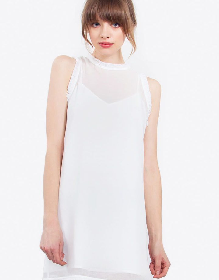 – White shift dress with fray trim – Gunmetal zipper on back – Slip dress inclided  Size + Fit – Model is wearing size S – Measurements taken from size S – Length: 33.25″ – Chest: 35″ – Waist: 37″