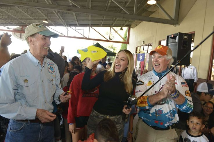Astros' Carlos Correa, fiancee surprise kids at fishing clinic  -  December 4, 2017.  Houston Astros' World Series champion Carlos Correa's fiancŽ Daniella Rodriguez in partnership with Vamos A Pescarª reels in her #FirstCatch at Bass Pro Shops Katy on Saturday, Dec. 2, 2017, in Katy, Texas. (Anthony Rathbun/AP Images for Bass Pro Shops)
