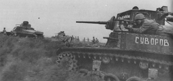 US-made M3 Stuart light tanks and M3 Lee medium tank in Russian service, Stalingrad, Nov 1942; note soldier with PPSh-41 submachine gun
