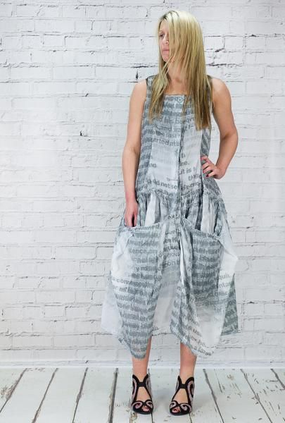 Rundholz 100% fine cotton sleeveless dress, semi sheer, but perfect to layer. Faded print detail.