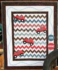 Road Rage. This fun activity quilt will keep your little one busy for hours.  Follow the outside track for fun, and park the cars neatly in the handy stop sign pocket.  A quilt that not only is fun to play with, it's also fun to cuddle with. http://www.kayewood.com/item/Road_Rage_Quilt_Pattern/2815/p2 $9.00