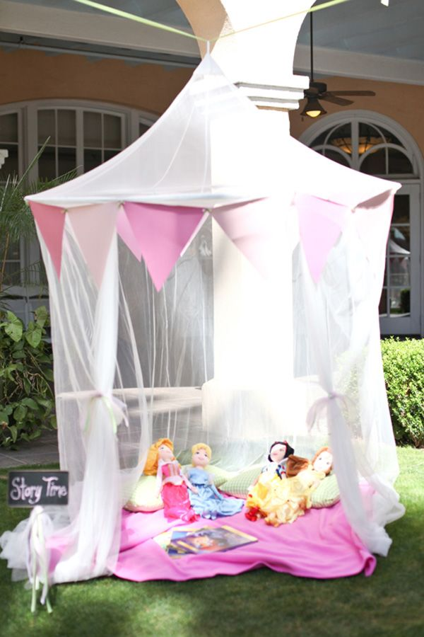 This outdoor insect netting tent available from Ikea were dressed up with fabric pennant banners. Astonishingly enough, Rainna doesn't have those Disney princess dolls. Yet. She saw them and now wants ALL of them.