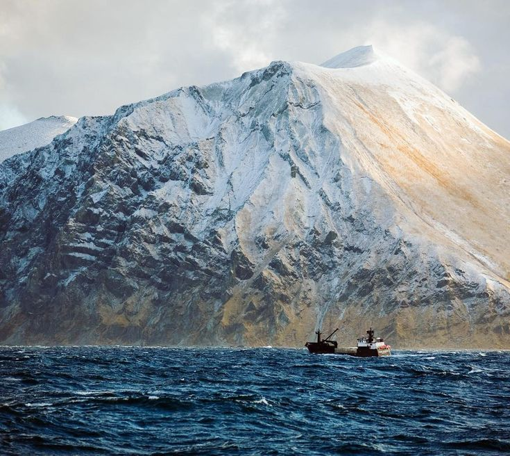 Photo and text by Corey Arnold @arni_coraldo   The f/v Time Bandit heads out of Dutch Harbor en route to the crabbing grounds during the January Opilio crab season. I remember my first time ever crabbing in the Bering Sea back in 2003.  As we left port we were greeted straight away by 20-30 foot waves 3 times bigger then Id ever seen before and with my inexperience seemed impossibly dangerous. But I quickly learned that there is nothing to worry about until you see wrinkles starting to form…