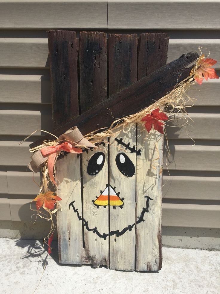 Scare crow hand painted on pallet ..