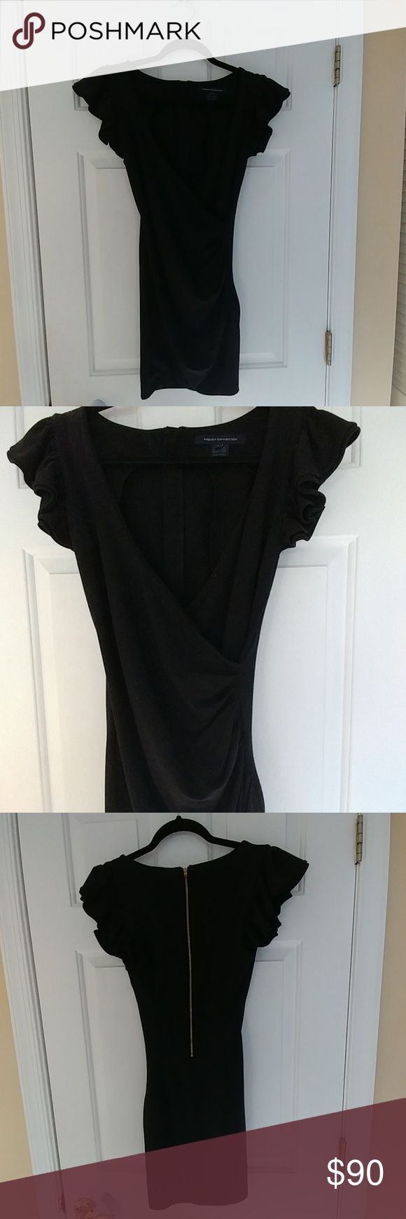 """French Connection Little Black Dress NWOT Never worn French Connection brand dress Size 4. Extremely well made, thicker stretchy material. wrap style with ruffled sleeves and plunging neckline with Zipper up the back. I'm 5""""3' and it hits me about mid though French Connection Dresses"""