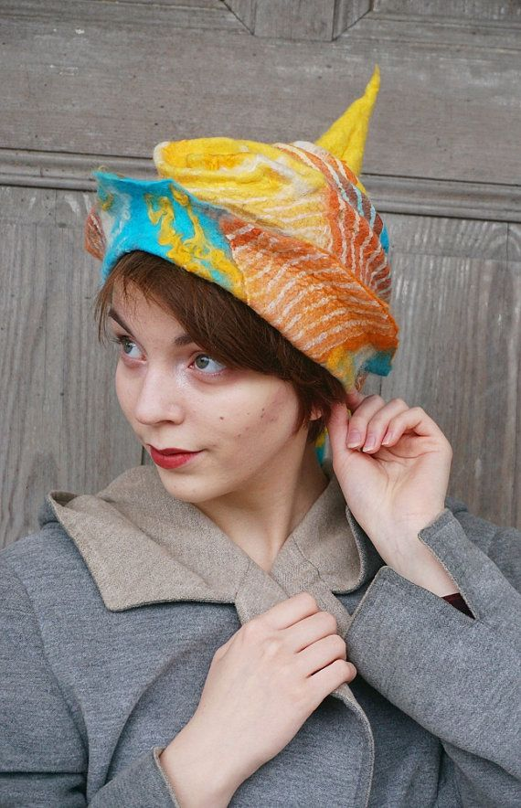 Hand felted designer hat, warm winter hat , pastel colors bohemian fashion, funky and unusual! Beautiful fancy felted hat with tip, one of a kind, shades of orange, yellow and turquoise, decorated with fancy dreadlocks. You can wear it in different ways! I made it nuno felt technique with silk fabric and merino wool , decorated with beautiful pieces of silk and wool curls. Light and elegant wearable art! This original hat will be a great accessory to your fall and winter outfit!  Head…