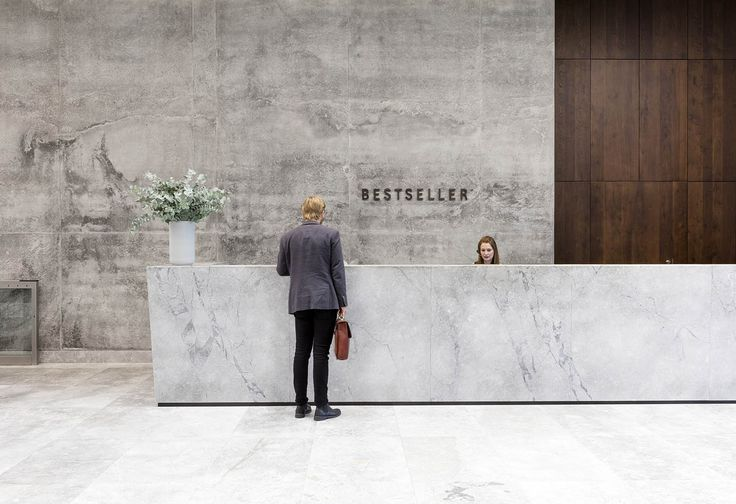 Strong use of logo behind a reception desk. Bestseller Aarhus,© Adam Mork