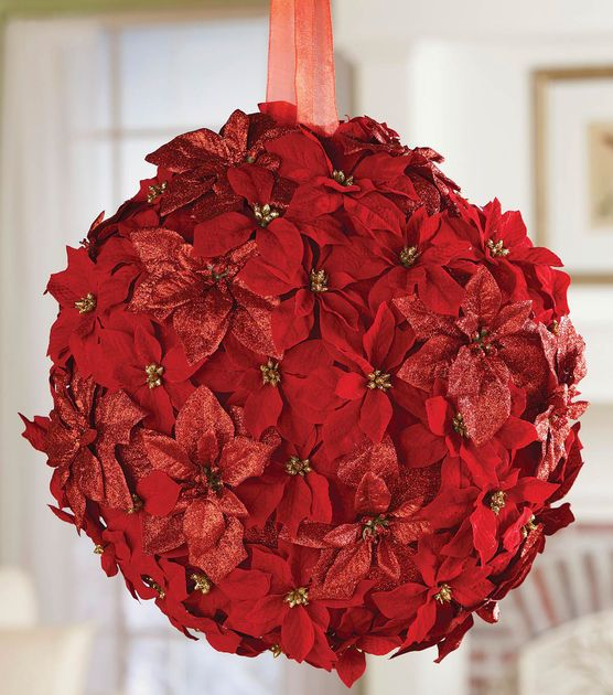 Decorate your home for the holidays with a festive poinsettia pinata! #fabulouslyfestive