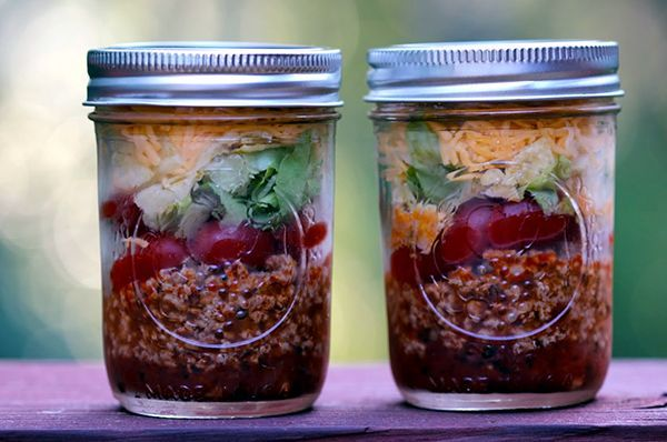 Skinny Taco Salad in a Jar - filled to the top with flavor and zesty energy!!  #skinnyrecipes #tacosalad #jarsalad