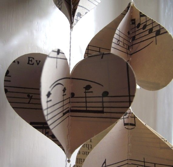 Old sheet music for wedding decorations (:   Maybe hang them along the wall as a backdrop for a photo area during the thing in the gym?