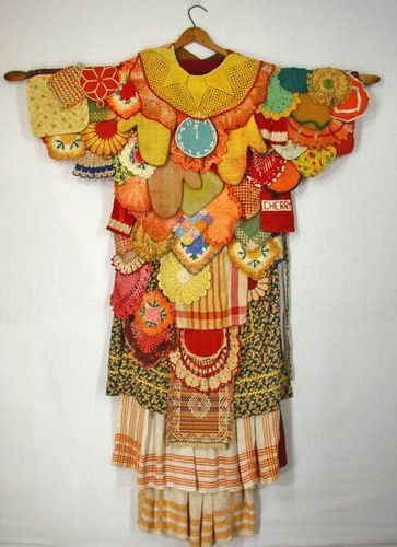 Domestic Armor, Diane Savona. Made from old potholders, aprons, doilies, and other fabric.