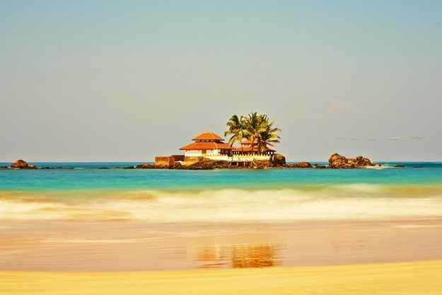 This Buddhist Temple on island near Hikkaduwa, Sri Lanka. | 19 Beautifully Isolated Places Where You Can Finally Get Some Peace And Quiet