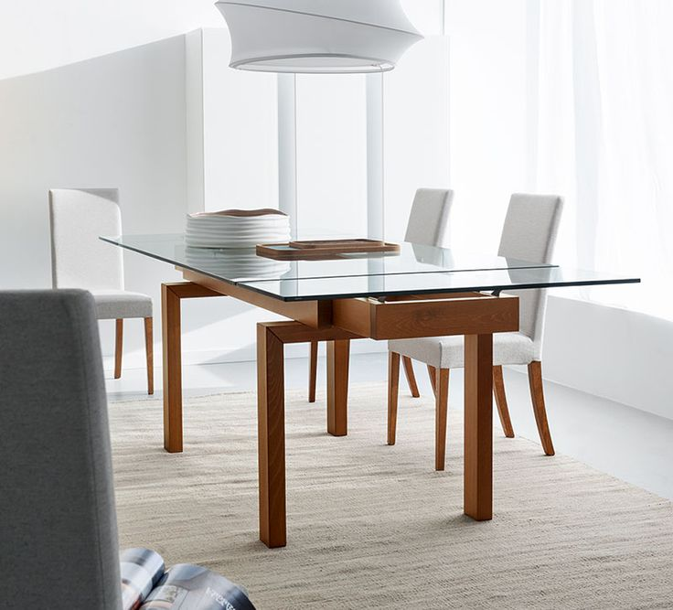 The Calligaris Hyper Extendable Dining Table Is A Simple Contemporary That Extends To 94 In Length Accomodating Up 10 Guests