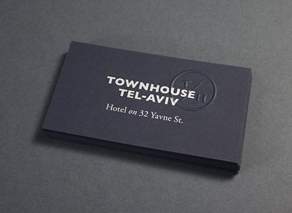 Business card with blind emboss monogram detail for Tel Aviv hotel Townhouse designed by Koniak.