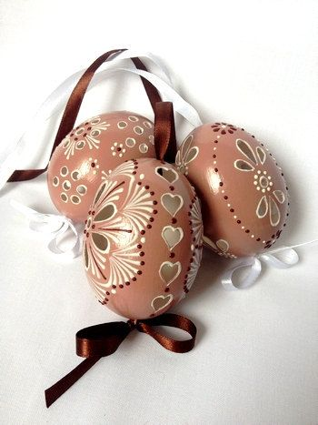 Hand painted Easter eggs.  This is a set of 3 brown color real chicken eggs Madeira with string, approximately the same size, painted colors and