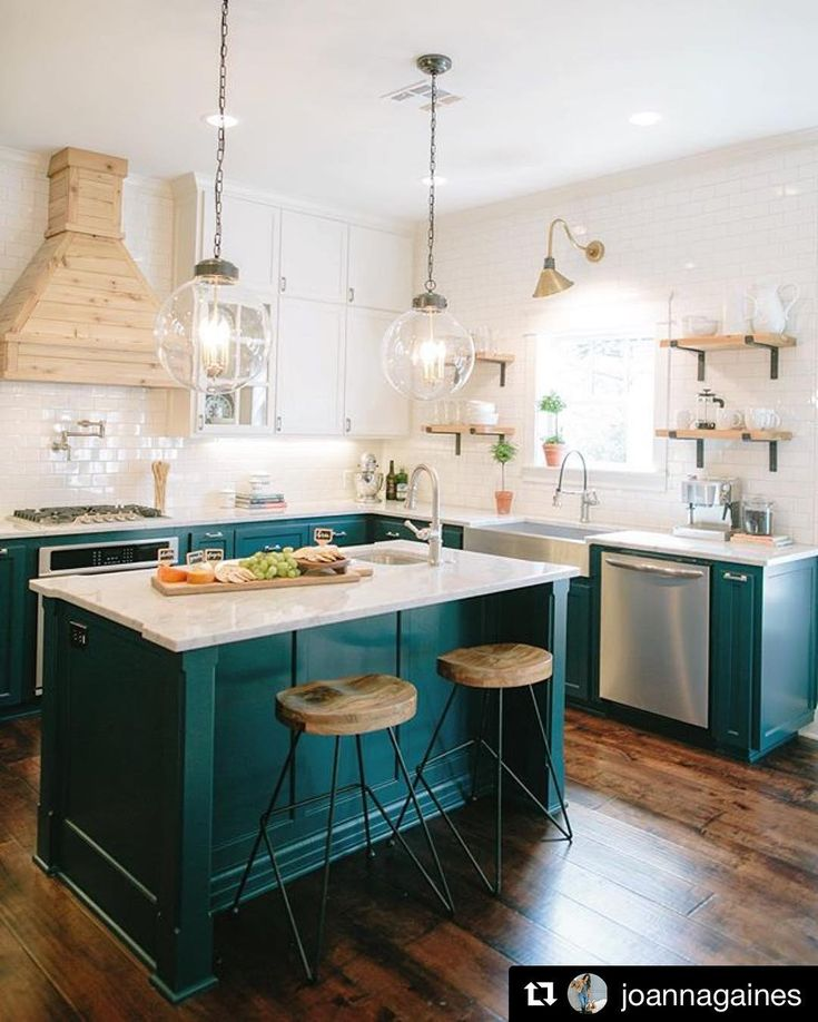 SWOON! How gorgeous are these teal cabinets?! LOVE the gold accents, too. Joanna takes color risks I dream of taking!