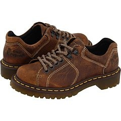 $109.99-$110.00 Dr. Martens 8312 W 6 Tie Shoe Tan Greenland 7 UK - Give your look a rugged finish with these offbeat Dr. Martens 8312 W oxfords. Full grain leather upper in a casual sneaker-inspired oxford style with a round toe. A 4-eyelet lace-up front with double D-ring top closures and a padded collar and tongue offer comfortable fit. Cushioning insole, grooved midsole with signature yellow ...