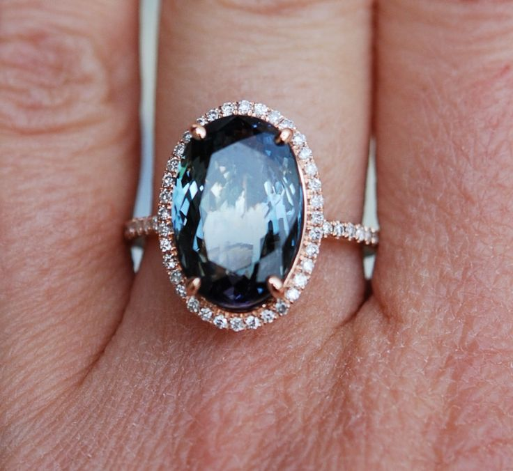this slightly resembles my grandmothers ring that i wore for many years - Tanzanite Wedding Rings