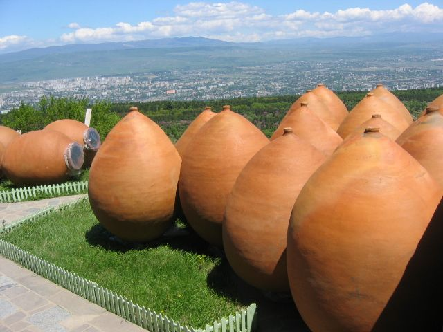 Kvevris in Georgia. Kvevris are large earthenware vessels used for the fermentation, storage and ageing of traditional Georgian wine. Resembling large, egg-shaped amphorae without handles, they are either buried below ground or set into the floors of large wine cellars. Kvevris vary in size: volumes range from 20 litres to around 10,000; 800 is typical.