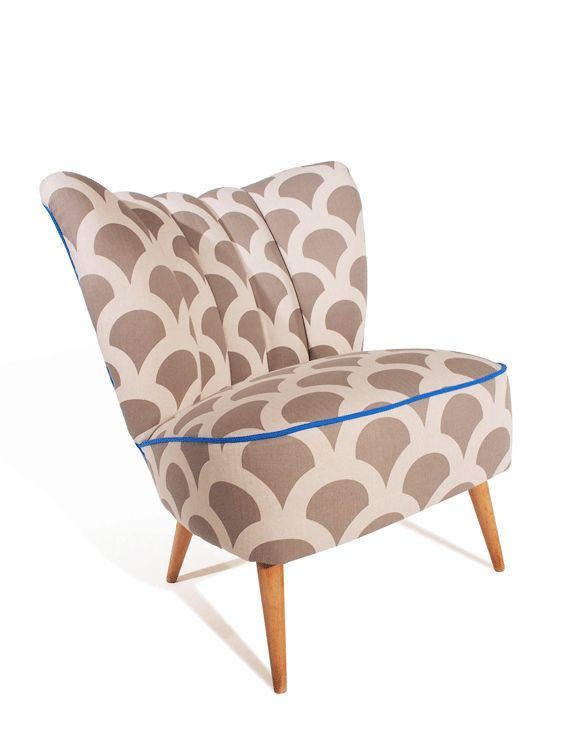 The Floreana cocktail chair with its fluted back makes an elegant statement in Korla's Grand Kyoto Koi trimmed with Cornflower Blue from Bute.