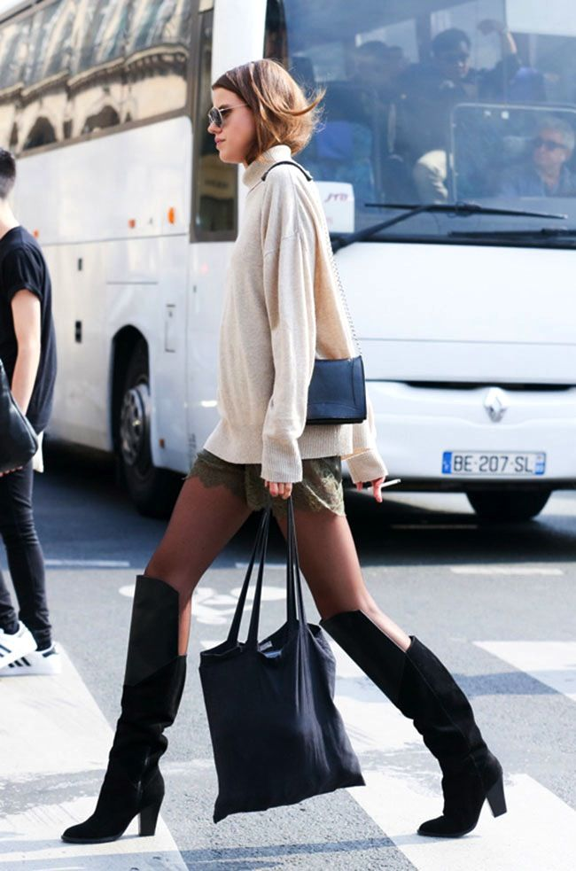 This street style look from Paris makes for great inspiration on how to transition lace shorts into fall. Add an oversized knit, tights, knee high boots and you're set!