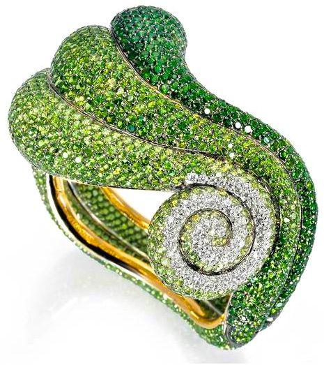 de Grisogono's Bangle of Green Tsavorites, Green Sapphires & Emeralds.
