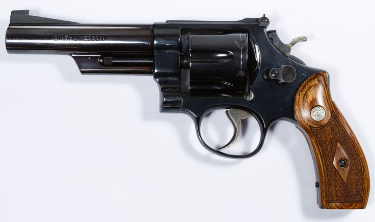 Lot 331: Smith and Wesson Model 25-2 .45 Cal. Revolver (Serial #N900328); Blue steel 1955 Model double action 6-shot revolver in wooden S&W presentation case with custom grips and six full moon speed load clips