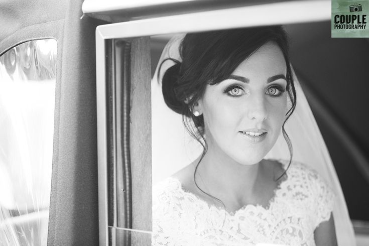 The stunning bride arrives at Kilquade church. Weddings at Druids Glen Resort by Couple Photography.